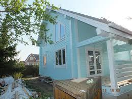 Чем покрасить деревянный дом снаружи?