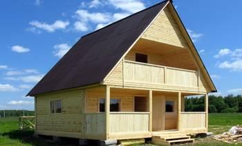 Дом с мансардой, балконом и террасой